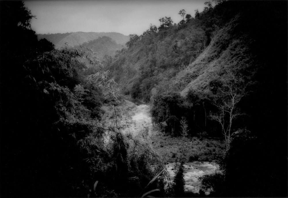 Fallow swidden fields in river valley, Sierra Madre Mountains, Philippines.