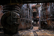 The Carrie Furnaces were built in 1881 as part of U.S. Steel's Homestead Works, a sprawling 400-acre complex that spanned both sides of the Monogahela river. They produced up to 1,250 tons of steel a day until 1978 when they were closed. <br /> <br /> While the majority of the site was razed for a shopping center, the 100-foot high furnaces still stand. The furnaces were designated as a national historic landmark in 2006 and preservation efforts are underway. (Photographed on May 14, 2014)