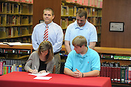 Lafayette High's Dylan Gossett (18) signs a National Letter of Intent to play football at Holmes Community College, in Oxford, Miss. on Wednesday, February 1, 2012.