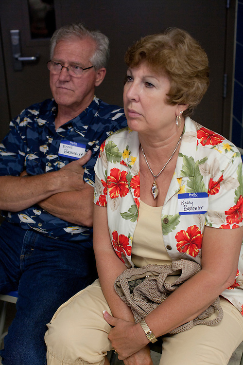 Ernie and Kathy Bachmeier listen to Republican presidential hopeful Tim Pawlenty speak at a fundraiser for the Linn County Republican Party on Friday, August 5, 2011 in Tiffen, IA.