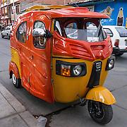 A mototaxi (three-wheeled auto rickshaw) provides cheap public transportation in Huaraz, in the Santa Valley (Callejon de Huaylas), Ancash Region, Peru, South America.