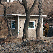 A North Korean soldier guards in the bank of the Yalu river in Sinuiju, North Korea, on Thursday, Feb. 8, 2007. The Six Party talks have started on the 8th of February in Beijing with the hope of terminating the nuclear program of North Korea