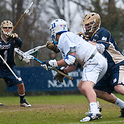 John Kemp Goalie #1 watches as Duke midfielder David Lawson #2 looks to beat his defender. The third-ranked Fighting Irish defeated sixth-ranked Duke, 13-5, in men's lacrosse action on a snowy Saturday afternoon at Koskinen Stadium in Durham, N.C.