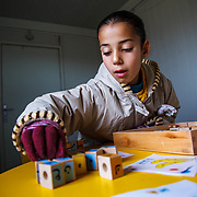 Hayam, 8, is in a one-on-one tutoring session, helping ensure she stays on track with her education, in Zaatari camp for Syrian refugees in Jordan, March, 2014. The first ten months after arriving in Zaatari, Hayam was unable to attend school. Her muscular dystrophy and her rapidly deteriorating muscles make the quarter-mile walk to class impossible. <br /> <br /> With her new wheelchair provided by Mercy Corps, Hayam was able to restart her education last month. Mercy Corps focuses on integrating children with disabilities into the school system.<br /> <br /> Produced with funds provided by Mercy Corps.