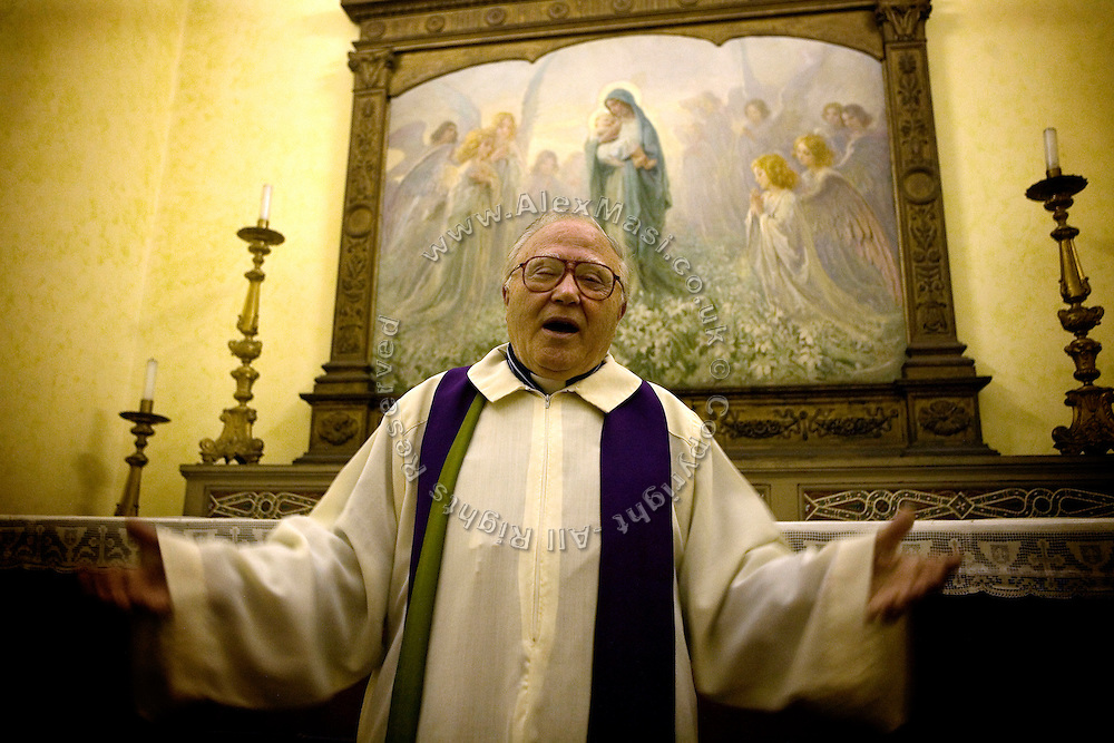 Father Igino Troiani, 77, from The Church of San Claudio, in Rome, Italy, is portrayed in the sacristy of his church where he normally carries out exorcisms. He has been an exorcist for around five years.<br /> <br /> FOR MORE INFORMATION PLEASE WRITE TO ALEX@ALEXMASI.CO.UK<br /> <br /> **TEXT AND LENGHTY INTERVIEWS AVAILABLE**