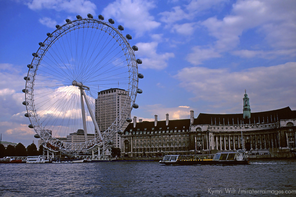 United Kingdom, Great Britain; England; London. The iconic London Eye on the River Thames.