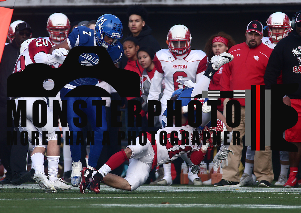 Smyrna defensive back Jacob Soroko (21) forces a fumble during the DIAA division one Football Championship game between Top-seeded Middletown (11-0) and second-seeded Smyrna (11-0) Saturday, Dec. 03, 2016 at Delaware Stadium in Newark.