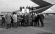 Irish Rugby team, which will play Wales..1965..11.03.1965..03.11.1965..11th March 1965..After wins against England (5-0), and Scotland (16-6). Ireland had high hopes of winning the Triple Crown in the decider against Wales in Cardiff. Wales had also beaten both England and Scotland...Image shows the Irish Rugby team, which will play Wales for the Triple Crown, on the tarmac at Dublin Airport as they prepare for departure to Cardiff.