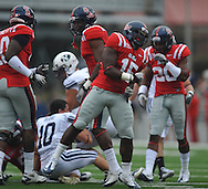 Ole Miss' Joel Kight (15) celebrates a tackle at Vaught-Hemingway Stadium in Oxford, Miss. on Saturday, September 3, 2011. BYU won 14-13.