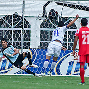 Panama Keeper Jaime Penedo #1 makes a diving attempt to save a goal during EL Salvador Attacker Rodolfo Zelaya #11 penalty kick attempt in the midst of the concacaf gold cup quarterfinals Sunday, June 19, 2011 at RFK Stadium in Washington DC.
