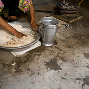 A family member of Ghair Bibi makes bread. <br /> Women traditionally run the house hold and make sure their families are fed. Even so, most women in Pakistan suffer from severe anemia, which counts for many of the complications during or shortly after delivering babies.  With food prices rising and vegetables and meat becoming too expensive, the problem only increases and more cases of malnourishment are reported in local hospitals. Karachi, Pakistan, 2011