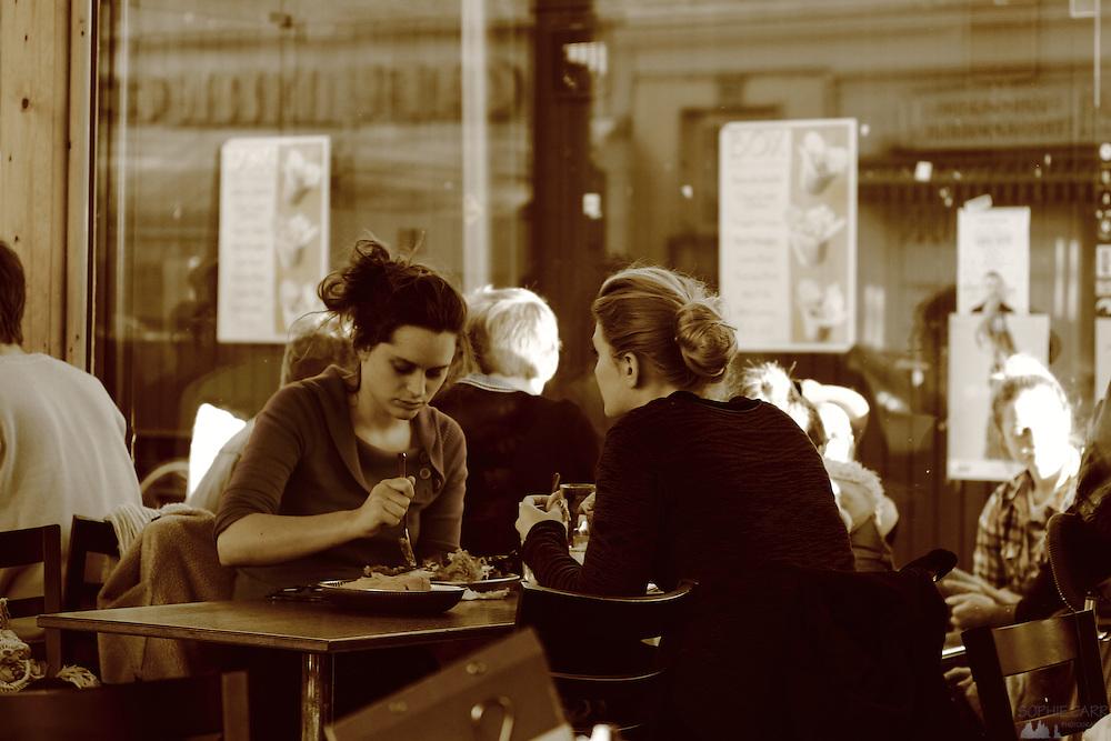 Two women tuck into lunch in a café in Vienna's Naschmarkt