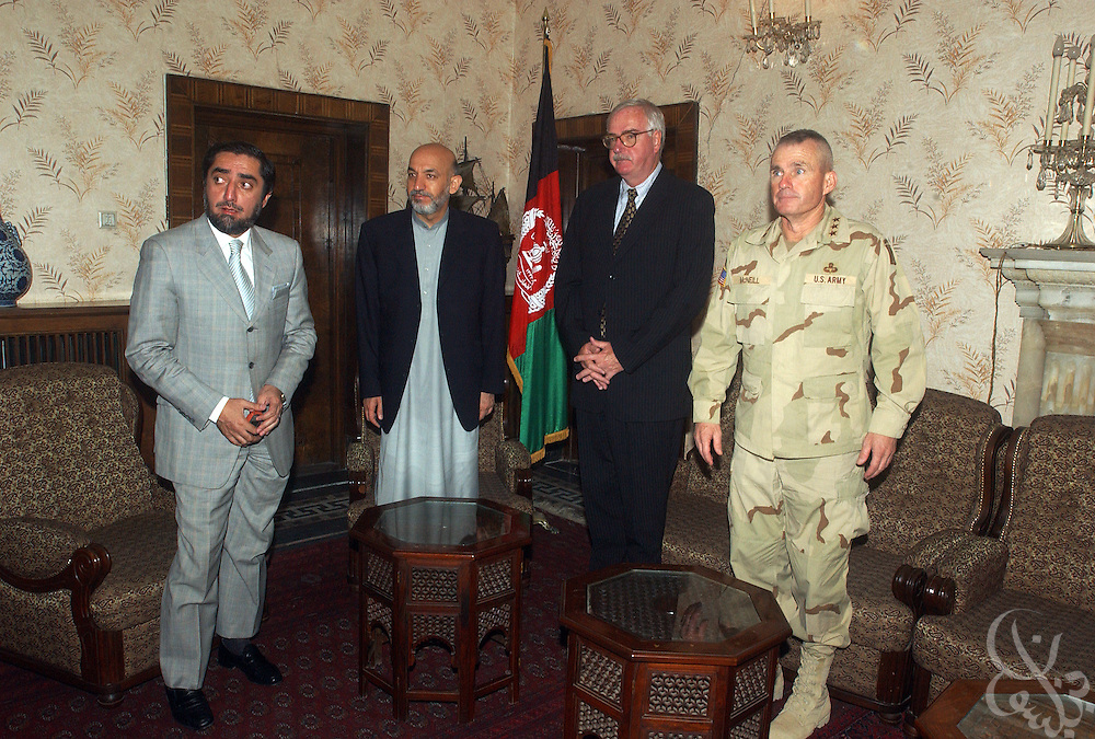 (From Right) US Army General Dan McNeill, Coalition Joint Task Force 180 commander, US Ambassador to Afghanistan Robert P. Finn, Afghan president Hamid Karzai and Afghan Foreign Minister Dr. Abdullah Abdullah gather for a July 6, 2002 meeting in Kabul regarding a US airstrike that killed innocent civilians last week in the Afghan village of Deh Rawud. McNeill, Karzai and other officials from both sides discussed today's return of two informal boards of inquiry from the site of the bombing and instigated a more formal inquiry to look into the incident.