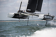 The Richard Mille GC32 foiling catamaran, skippered by Paul Campbell-James with Nick Hutton, Pete Cummings and Adam Piggot. Pictured here training prior to the 2014 J P Morgan Asset Management Round The Island Race.<br /> Credit: Lloyd Images