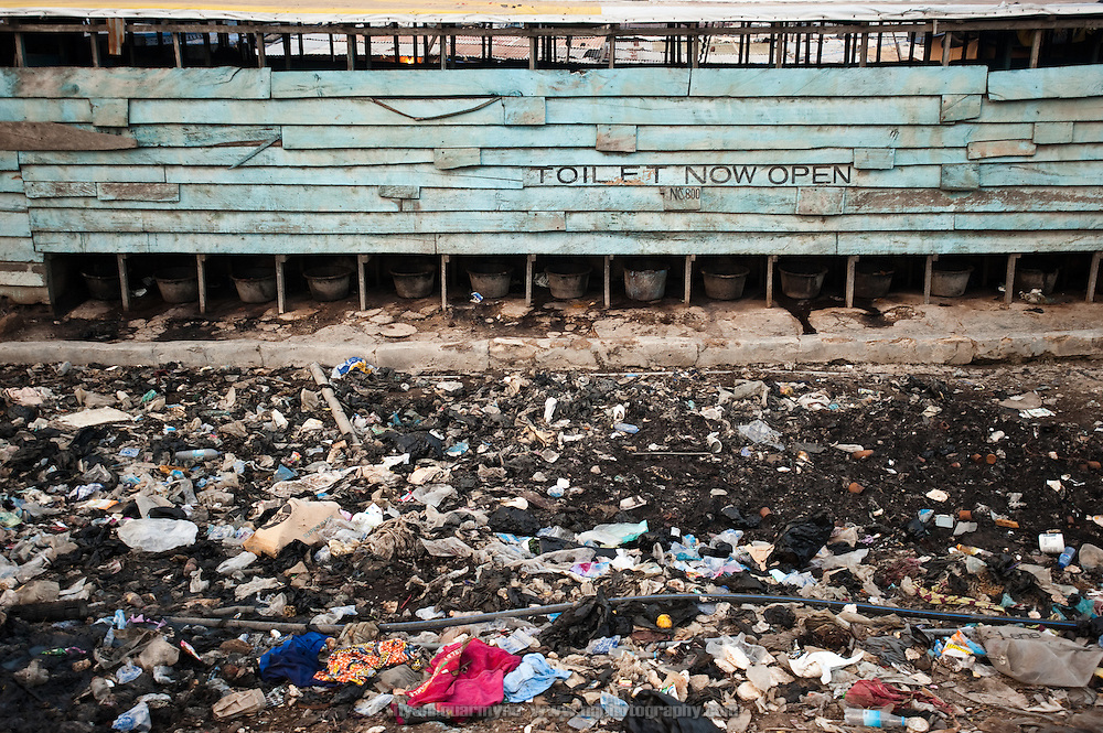 In the almost total absence of government-provided services, what limited toilet facilities exist in Old Fadama are privately owned and operate on a pay-per-use basis. No systemic waste disposal infrastructure exists, and the situation is compounded by the fact that people who cannot pay often defecate near such toilets, or dispose of excrement around them. Colloquially referred to as 'Sodom and Gomorrah, Old Fadama is located in Ghana's capital Accra and is home to some some 80,000 people.