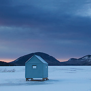 Ice fishing shacks on Eagle Lake,  Acadia National Park, await their intrepid  occupants in. The park is a meeting place for sportsman and helps support traditional activities. It's a typical midwinter morning in downeast Maine with the temperature at 1 degree F and a wind chill of -15F.