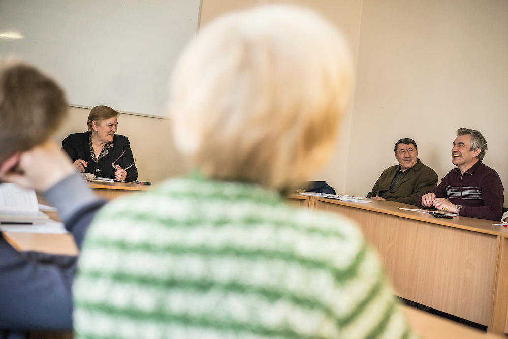 Ewa Holodkova, 67, left, from the town of Stakhanov in Lugansk oblast, teaches a Polish language class to students of whom many are IDPs from eastern Ukraine on Tuesday, April 28, 2015 in Lviv, Ukraine. Despite being a Polish citizen and she and her husband having the legal right to live in Poland, where they have a daughter, their Ukrainian pensions are too small to afford life in Poland. CREDIT: Brendan Hoffman/Prime for the Wall Street Journal UKRMIGRATION CREDIT: Brendan Hoffman/Prime for the Wall Street Journal UKRMIGRATION