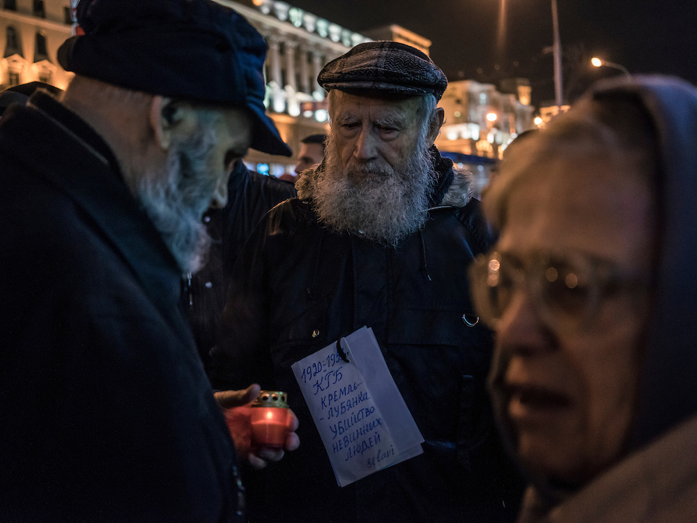 People light candles at the start of a rally organized by Mikalai Statkevich, a former opposition presidential candidate and political dissident, to commemorate the nineteenth anniversary of a referendum which enshrined authoritarian changes in Belarus's constitution on Tuesday, November 24, 2015 in Minsk, Belarus.