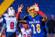 Grant High School Pacer's Dasuede Singleton (28), rcelebrates his touchdown run  to lead 21-0 after the point after attempt was good during the first quarter as the Grant Pacers host the Beyer High School Patriots in the Sac-Joaquin Section/Les Schwab Tires Division II first round playoff game, Monday Nov 16, 2015. Last Fridays game was rescheduled for this evening after senior football player Jaulon Clavo was shot and killed and another shot just hours before the game.<br /> Brian Baer/Special to the Bee
