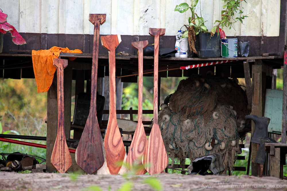 South America, Brazil, Amazon. Oars rest against structure on stilts in preparation for rising waters of the Amazon.