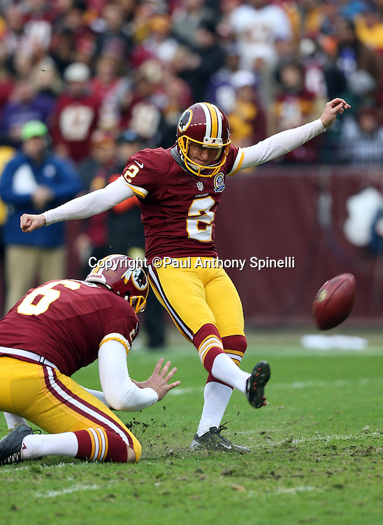 Washington Redskins punter Sav Rocca (6) holds while Washington Redskins kicker Kai Forbath (2) kicks a first quarter PAT extra point for a 7-0 lead during the NFL week 14 football game against the Baltimore Ravens on Sunday, Dec. 9, 2012 in Landover, Md. The Redskins won the game in overtime 31-28. ©Paul Anthony Spinelli