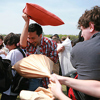 A man braces himself for a hit during International Pillow Fight Day on The National Mall in Washington, DC on Saturday, April 3, 2010.