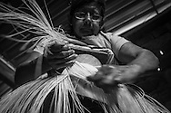 "2015/03/13 - Pile, Ecuador: Mariana Rivera, 73, weaves a ""Montecristi hat"" in her house early in the morning. She started to weave hats at the age of 10. Nowadays she doesn't weave the finest hats as before because her eyes are tired and old as she says. So, Mariana uses thicker straw to weave a hat, which brings the price down. She sells them at around US$200, but sometimes even less if she is really desperate for money.  UNESCO declared the ""Montecristi hat"" in 2012 as Intangible Cultural Heritage of Humanity."
