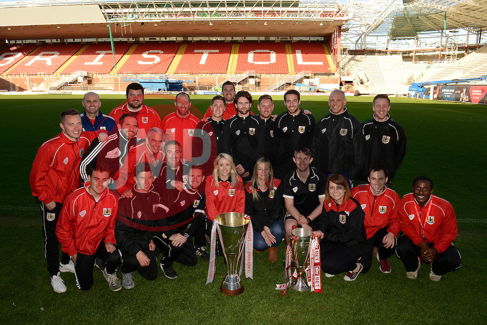 Bristol City academy staff pose for photos with the Johnstone Paint Trophy and Sky Bet League One trophy - Photo mandatory by-line: Dougie Allward/JMP - Mobile: 07966 386802 - 12/05/2015 - SPORT - Football - Bristol - Ashton Gate Stadium - Bristol City Academy