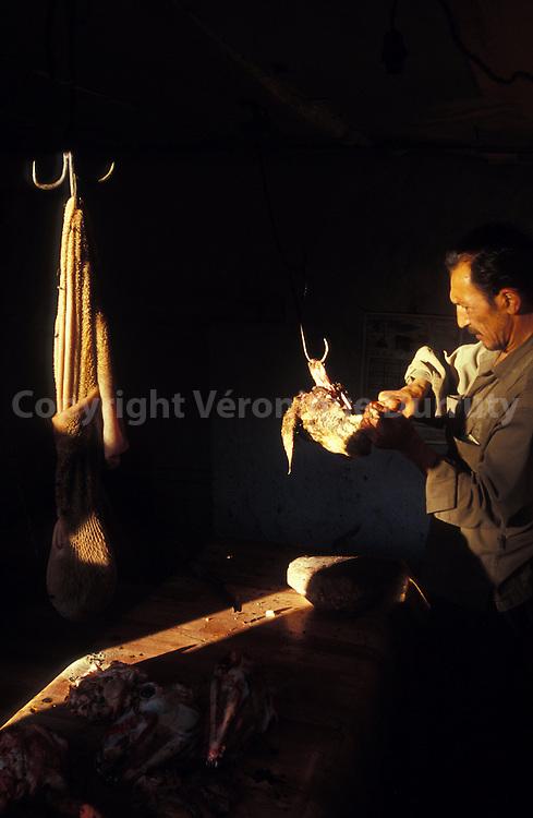 BUTCHER IN HIS SHOP. LEH, LADAKH, INDIA
