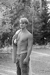 All American man without a shirt outdoors with a blanket