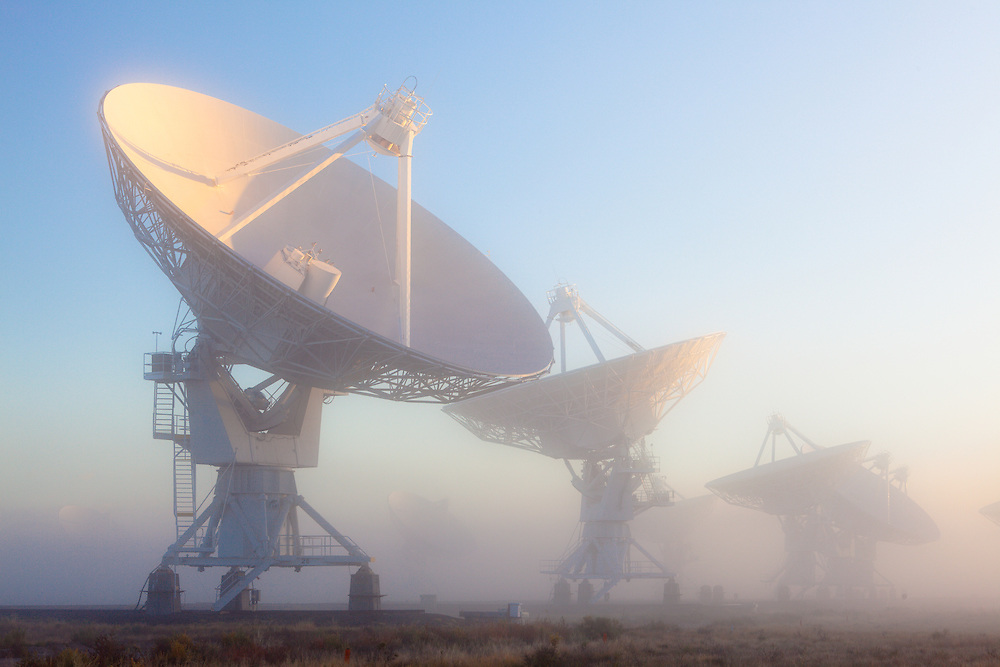 The Very Large Array (VLA) in fog. The VLA is a site of the National Radio Astronomy Observatory (NRAO) and is located west of Magdalena, New Mexico.