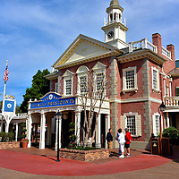Hall of Presidents in Liberty Square at Magic Kingdom in Orlando, Florida<br /> The Hall of Presidents in Liberty Square is modeled after America&rsquo;s most historic building: Independence Hall. The original Pennsylvania State House was finished in 1753.  In 1776, the Declaration of Independence was approved here. In 1787, the Georgian building witnessed the writing of the U.S. Constitution. What a fitting venue for Disney to assemble all of the United States&rsquo; presidents for a multi-media show called audio-animatronics. The Magic Kingdom attraction combines a patriotic film of our country&rsquo;s history, life-size models of our leaders plus speeches by George Washington, Abe Lincoln and the current president.