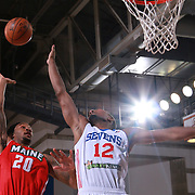 Delaware 87ers Forward SAM THOMPSON (12) attempts to block Maine Red Claws Guard LEVI RANDOLPH (20) shot attempt in the first half of a NBA D-league regular season basketball game between the Delaware 87ers and the Maine Red Claws  Friday, Feb. 05, 2016 at The Bob Carpenter Sports Convocation Center in Newark, DEL.