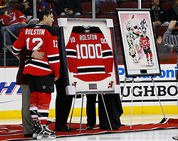 Jan 21, 2008; Newark, NJ, USA; New Jersey Devils center Brian Rolston (12) receives an award for playing in his 1000th NHL game before the Devils game against the Canadiens at the Prudential Center.