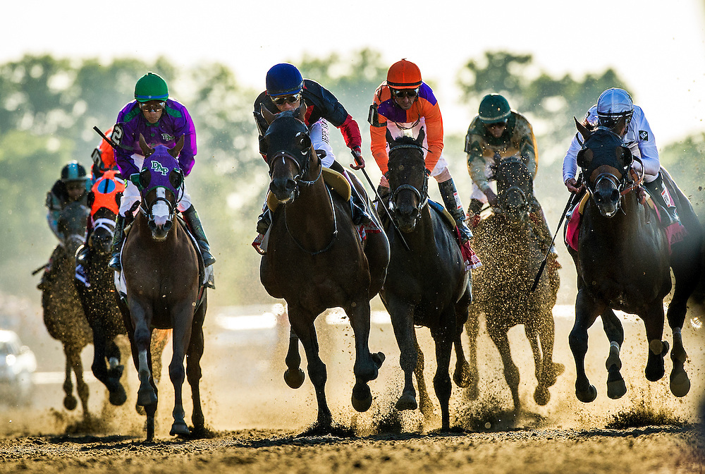 June 07, 2014: Tonalist with Joel Rosario (navy cap) defeats Commissioner and Javier Castellano (right) to win the Belmont Stakes ending California Chrome's bid at a Triple Crown at Belmont Park in Elmont New York. Alex Evers/ESW/CSM