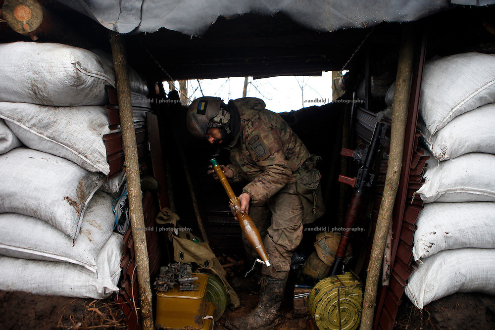 Ben put rocket propelled grenate parts together in a trench shelter at DOnetsk frontline.<br />