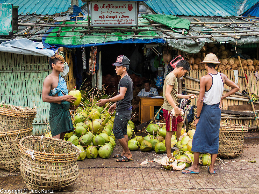 "10 JUNE 2014 - YANGON, MYANMAR:   The ""banana jetty"" is on the Yangon River north of central Yangon on Strand Road. Bananas, coconuts and other fruit are brought in here from upcountry, sold and reshipped to other parts of Myanmar (Burma). All of the labor here is done by hand. Porters carry the produce to the jetty and porters load the boats before they steam upriver.   PHOTO BY JACK KURTZ"