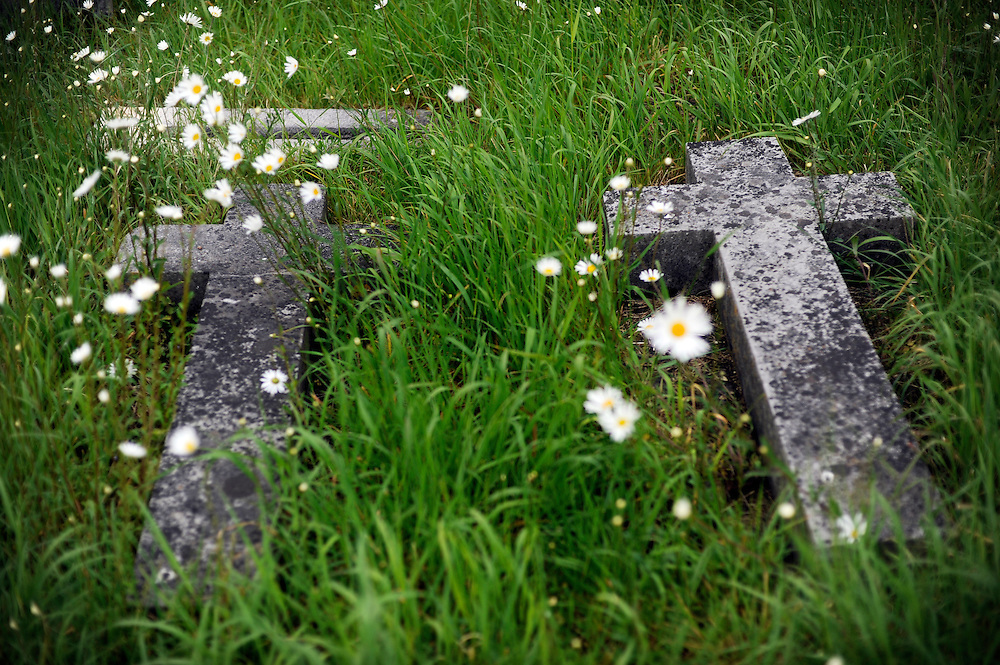Fallen headstones on the grounds of St. Candice's Cathedral in Kilkenny, Ireland.