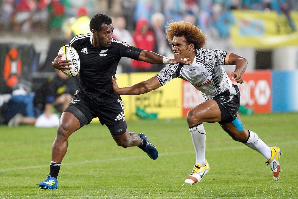 New Zealand's Tomasi Cama holds off an attack by Osea Kolinisau of Fiji as he runs for the line during the final of the IRB Sevens Tournament, Wellington, New Zealand, Saturday February 04, 2012. Credit: SNPA / Dean Pemberton