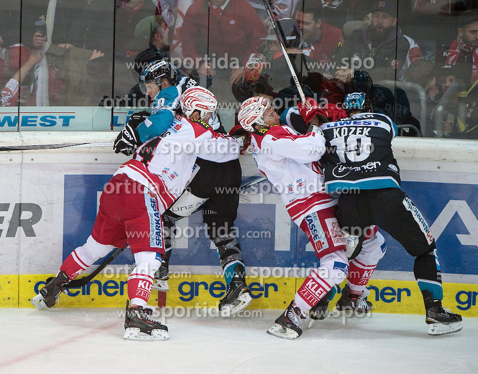 28.12.2015, Keine Sorgen Eisarena, Linz, AUT, EBEL, EHC Liwest Black Wings Linz vs EC KAC, 36. Runde, im Bild Andrew Jacob Kozek (EHC Liwest Black Wings Linz) und Jason Ulmer (EHC Liwest Black Wings Linz) kämpfen an der Bande // during the Erste Bank Icehockey League 36th round match between EHC Liwest Black Wings Linz and EC KAC at the Keine Sorgen Icearena, Linz, Austria on 2015/12/28. EXPA Pictures © 2015, PhotoCredit: EXPA/ Reinhard Eisenbauer