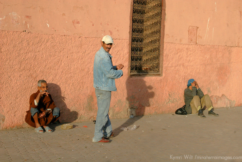 North Africa, Africa, Morocco, Marrakesh. Three Moroccan men on the street in Marrakesh.