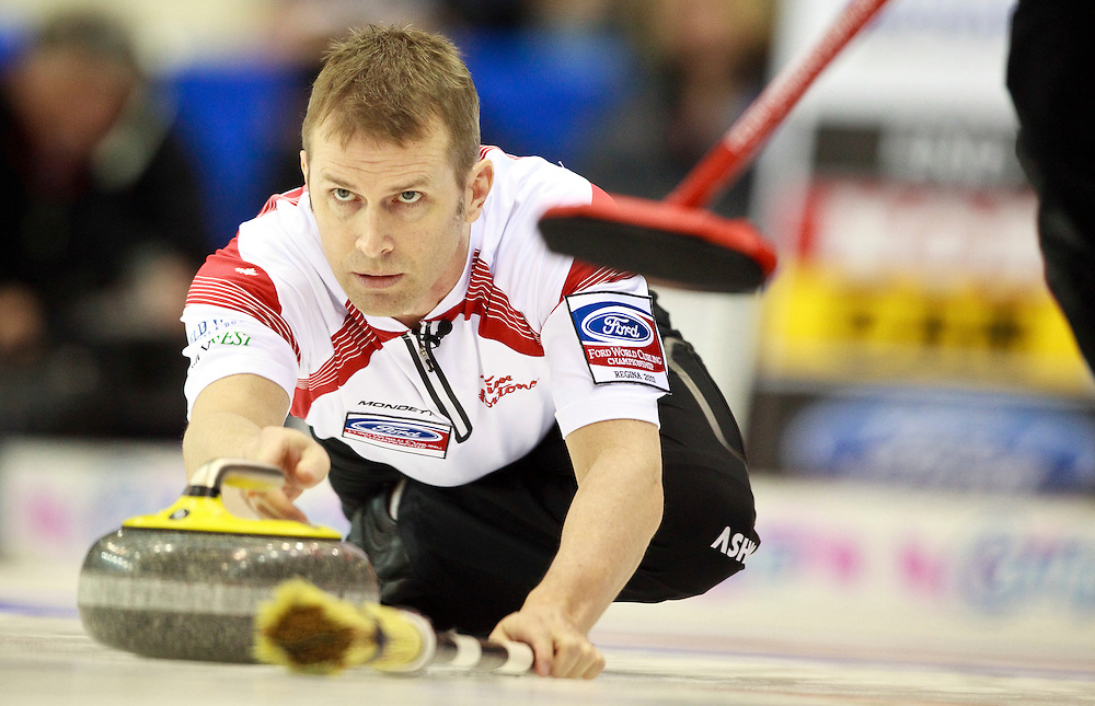 Canada's Skip Jeff Stoughton delivers a shot during Canada's 6-7 loss to Norway in the evening draw at the Ford World Men's Curling Championships at the Brandt Centre in Regina, Saskatchewan, April 7, 2011.<br /> AFP PHOTO/Geoff Robins