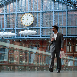 London, UK - 18 April 2013: A passenger walks by with in St Pancras International station on the day a new piece of public art, Cloud: Meteoros by Lucy Orta, is unveiled above the Grand Terrace.