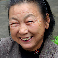 Asia, China, Guangxi, Daxu. The joyous smile of a resident of Daxu ancient town in southern China.