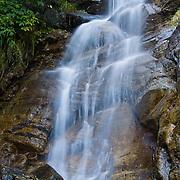 A waterfall plunges in Val Bregaglia near Maloja Pass, Grison Alps, Switzerland, Europe.