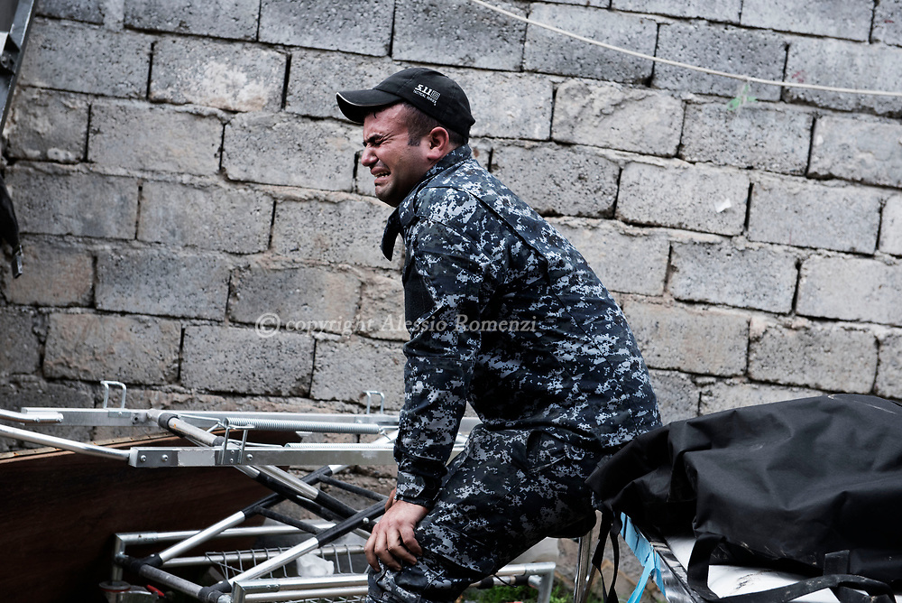 Iraq, Mosul: An Iraqi soldier reacts for the loss of one of his comrades in west Mosul. Alessio Romenzi