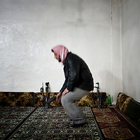 SYRIA - Al Qsair. A member of Free Syrian Army prays in a mosque in Al Qsair, on January 24, 2012. Al Qsair is a small town of 40000 inhabitants, located 25Km south-west of Homs. The town is besieged since the beginning of November and so far it counts 65 dead. ALESSIO ROMENZI