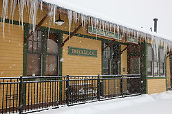 """Snowy Truckee, CA Visitor Center"" - Photograph of a snowy and icicle covered Visitor Center in Historic Downtown Truckee, California."