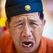 This traditional Chinese storyteller emphasizes this point with every muscle in his face.