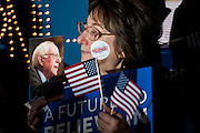 A supporter of Senator and 2016 Republican presidential candidate, Bernie Sanders (D-VT), waits for the candidate to arrive for a campaign event at Grand View University's Sisam Arena in Des Moines, IA on January 31, 2016. Sanders is in Iowa campaigning in the final days before the Iowa Caucus.<br /> <br /> The Iowa Caucus is the first major electoral event of the nominating process for President of the United States. Both the Democratic and Republican Iowa Caucus will occur on February 1, 2016.